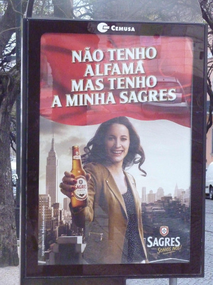 "Advertisement for Sagres beer, says ""I don't have Alfama but I have my Sagres."" Photo by Dennis Zuev;"
