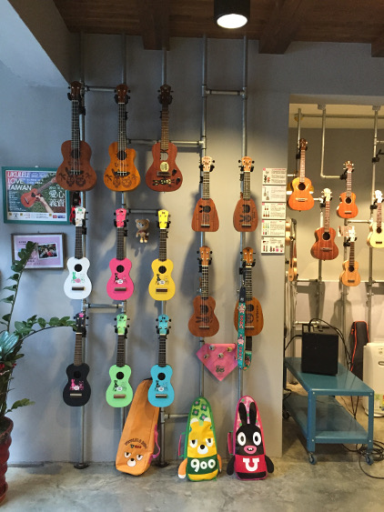 A display of customized ukeleles in the Anuenue shop. Photo by Debra Occhi.