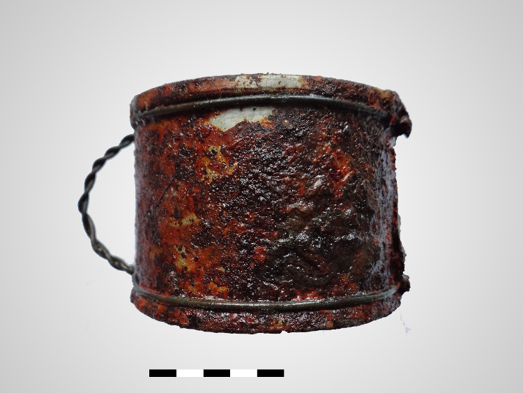 Figure 7. A cup made of food tin and metal wire preserved in a good condition till present. Photo by Dawid Kobiałka.