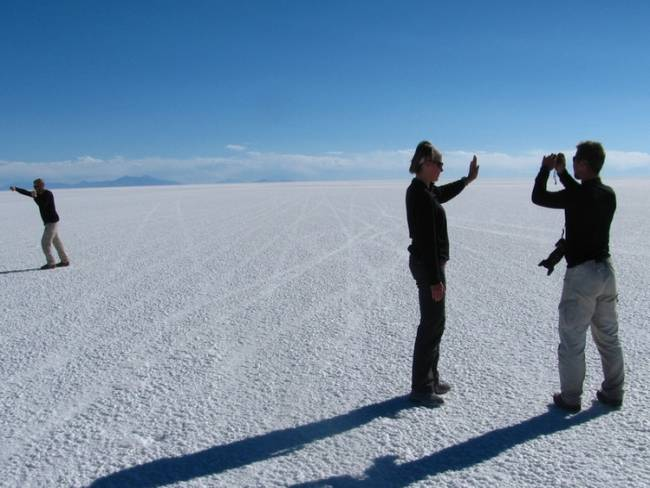 Photographing tourists taking photos at Salar de Uyuni, Bolivia. Photo by David Thompson.