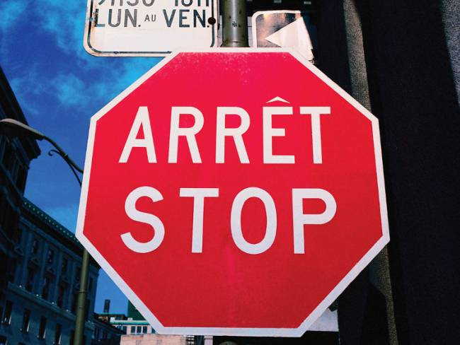 A bilingual stop sign in Quebec. Photo via Kids Brittanica.