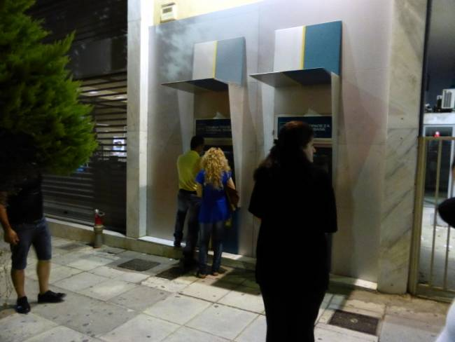 ATM line in Greece. Photo by Stamatis Amarianakis