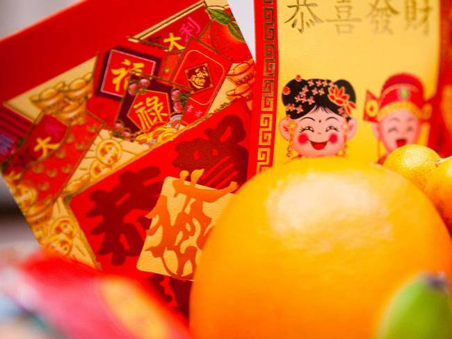 """Happy Chinese New Year"" showing red envelopes. Photo by Kenny Louie via Wikipedia."