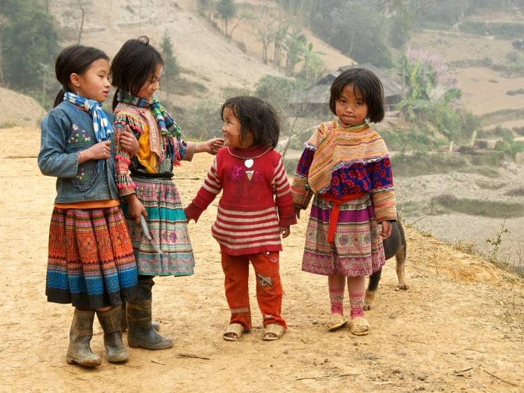 Hmong children in the mountains of North Vietnam by Lance Richardson
