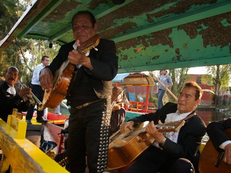 Musicians performing in Xochimilco, Mexico by Lance Richardson